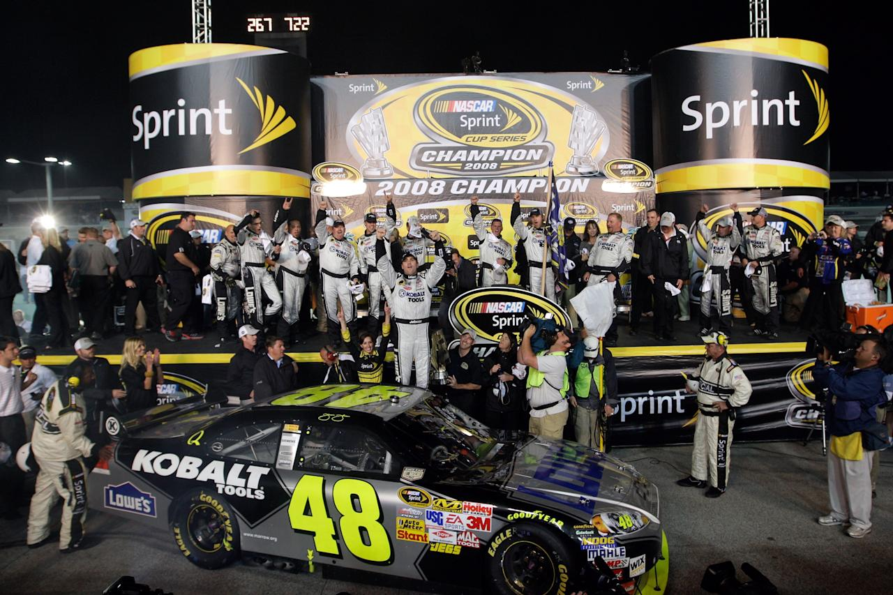 Jimmie Johnson, driver of the #48 Lowe's/Kobalt Tools Chevrolet, celebrates with his crew members after winning the 2008 NASCAR Sprint Cup Series Championship after the Ford 400 at Homestead-Miami Speedway on November 16, 2008 in Homestead, Florida.  (Photo by John Harrelson/Getty Images for NASCAR)