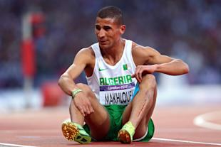 Taoufik Makhloufi sits on the track in the Men's 1500m Semi Final (Getty Images)