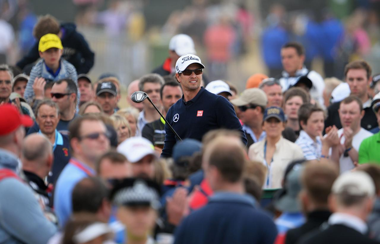GULLANE, SCOTLAND - JULY 21: Adam Scott of Australia watches his tee shot on the 11th hole during the final round of the 142nd Open Championship at Muirfield on July 21, 2013 in Gullane, Scotland. (Photo by Stuart Franklin/Getty Images)