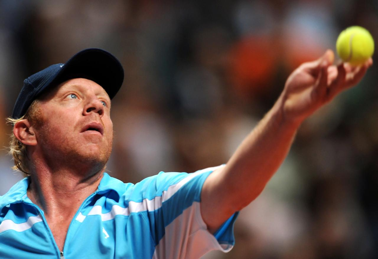 (FILES) - Picture taken on March 29, 2008 shows German Boris Becker serving to US Jim Courier during his Madrid's Masters Senior match against in Madrid. Becker has said on October 31, 2012 he is considering becoming Germany's Davis Cup team captain after Patrik Kuehnen on Wednesday announced his resignation from the start of 2013.  AFP PHOTO / JAVIER SORIANOJAVIER SORIANO/AFP/Getty Images