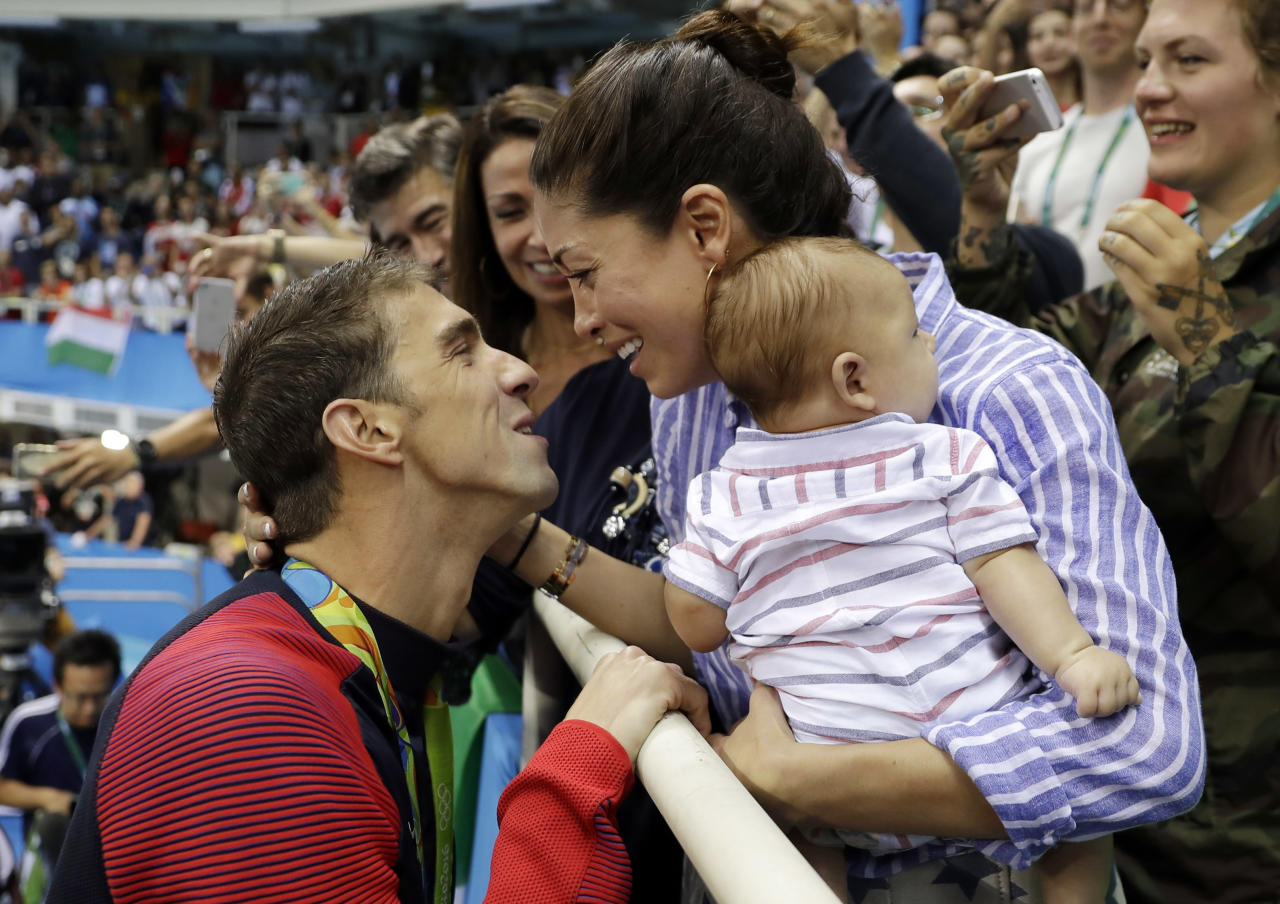 <p> FILE - In this Aug. 9, 2016, file photo, United States' swimmer Michael Phelps celebrates winning his gold medal in the men's 200-meter butterfly with his fiance Nicole Johnson and baby Boomer during the swimming competitions at the 2016 Summer Olympics, in Rio de Janeiro, Brazil. The Arizona Republic reported Oct. 26, 2016, that Phelps and Johnson secretly married on June 13, 2016. (AP Photo/Matt Slocum, File) </p>