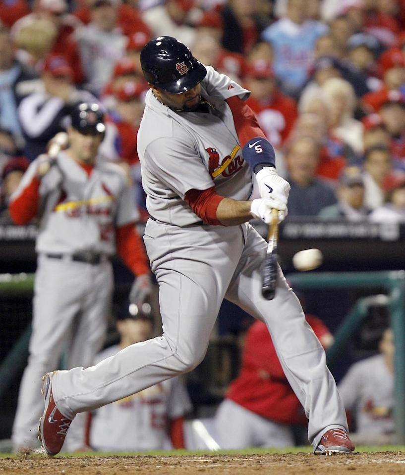 St. Louis Cardinals' Albert Pujols (5) hits an RBI single during the seventh inning of baseball's Game 2 of the National League division series with the Philadelphia Phillies Sunday, Oct. 2, 2011 in Philadelphia. (AP Photo/Matt Rourke)