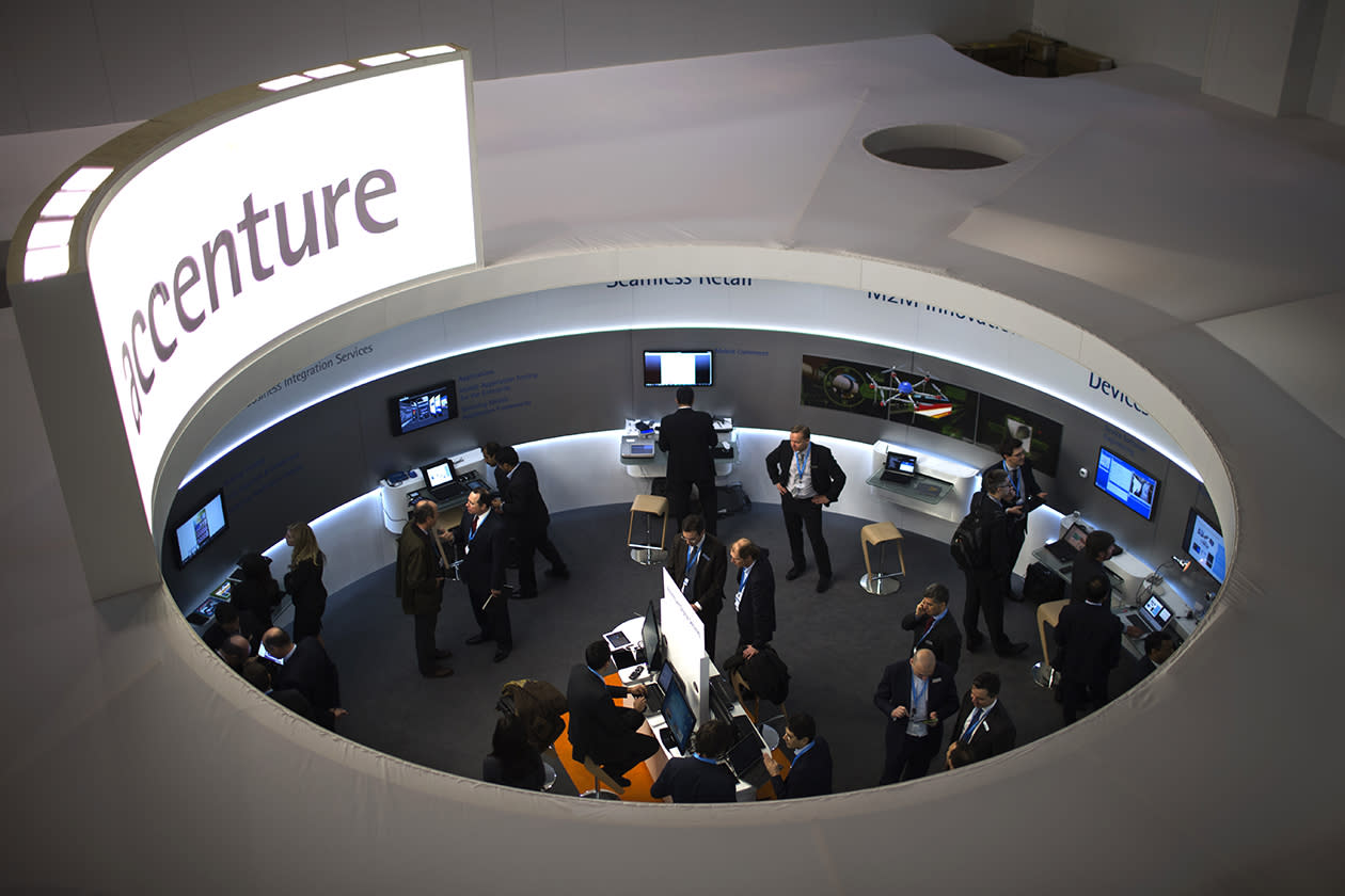 Attendees are seen in one of the pavilion of the Mobile World Congress.
