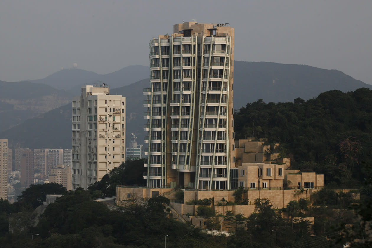 "The luxury residential building ""Opus Hong Kong,"" right, designed by Frank Gehry soars in Mid-Levels East of Hong Kong"