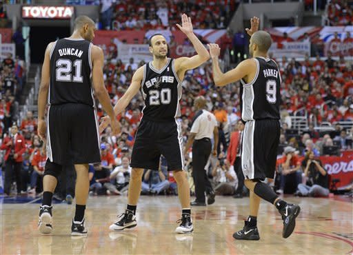 San Antonio Spurs guard Manu Ginobili, center, of Argentina, celebrates with center Tim Duncan, left, and guard Tony Parker of France right, during the second half in Game 3 of an NBA basketball playoffs Western Conference semifinal against the Los Angeles Clippers, Saturday, May 19, 2012, in Los Angeles. The Spurs won 96-86. (AP Photo/Mark J. Terrill)