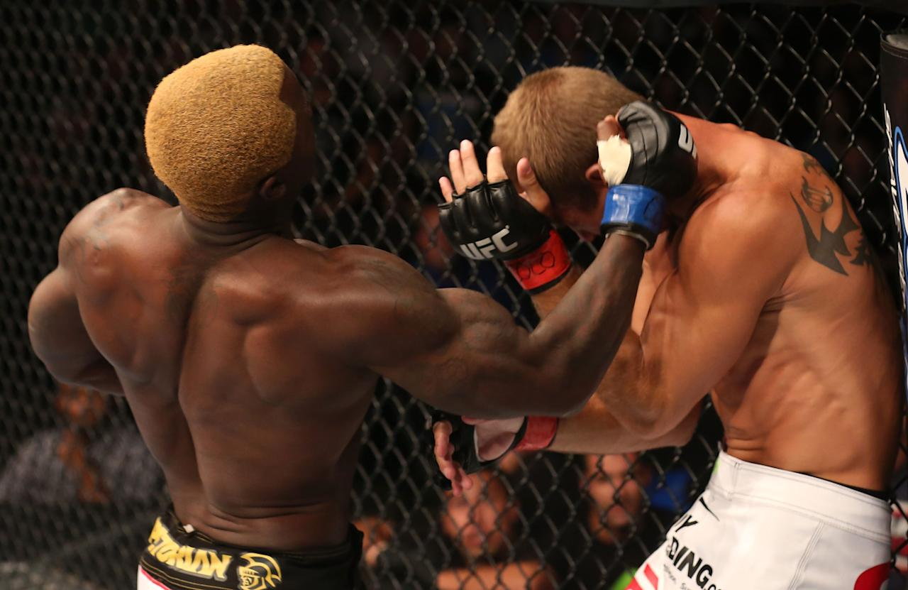 Melvin Guillard punches Donald Cerrone during their lightweight bout at UFC 150 inside Pepsi Center on August 11, 2012 in Denver, Colorado. (Photo by Nick Laham/Zuffa LLC/Zuffa LLC via Getty Images)