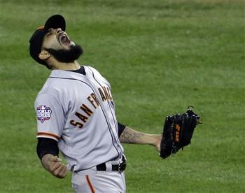 Sergio Romo reacts after striking out the Tigers' Miguel Cabrera to win the World Series. (AP)