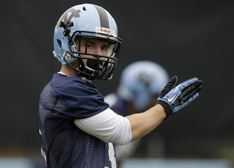 In this photo taken Friday, Aug. 1, 2014, North Carolina wide receiver Ryan Switzer signals a teammate during an NCAA football practice in Chapel Hill, N.C