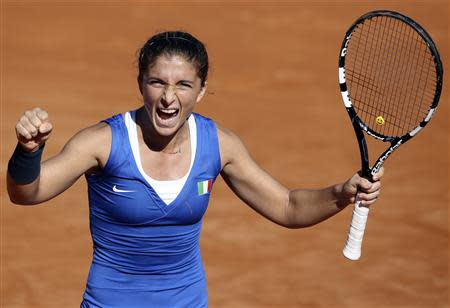 Italy's Errani celebrates after winning a match against Russia's Kleybanova during their Fed Cup World Group final tennis match in Cagliari