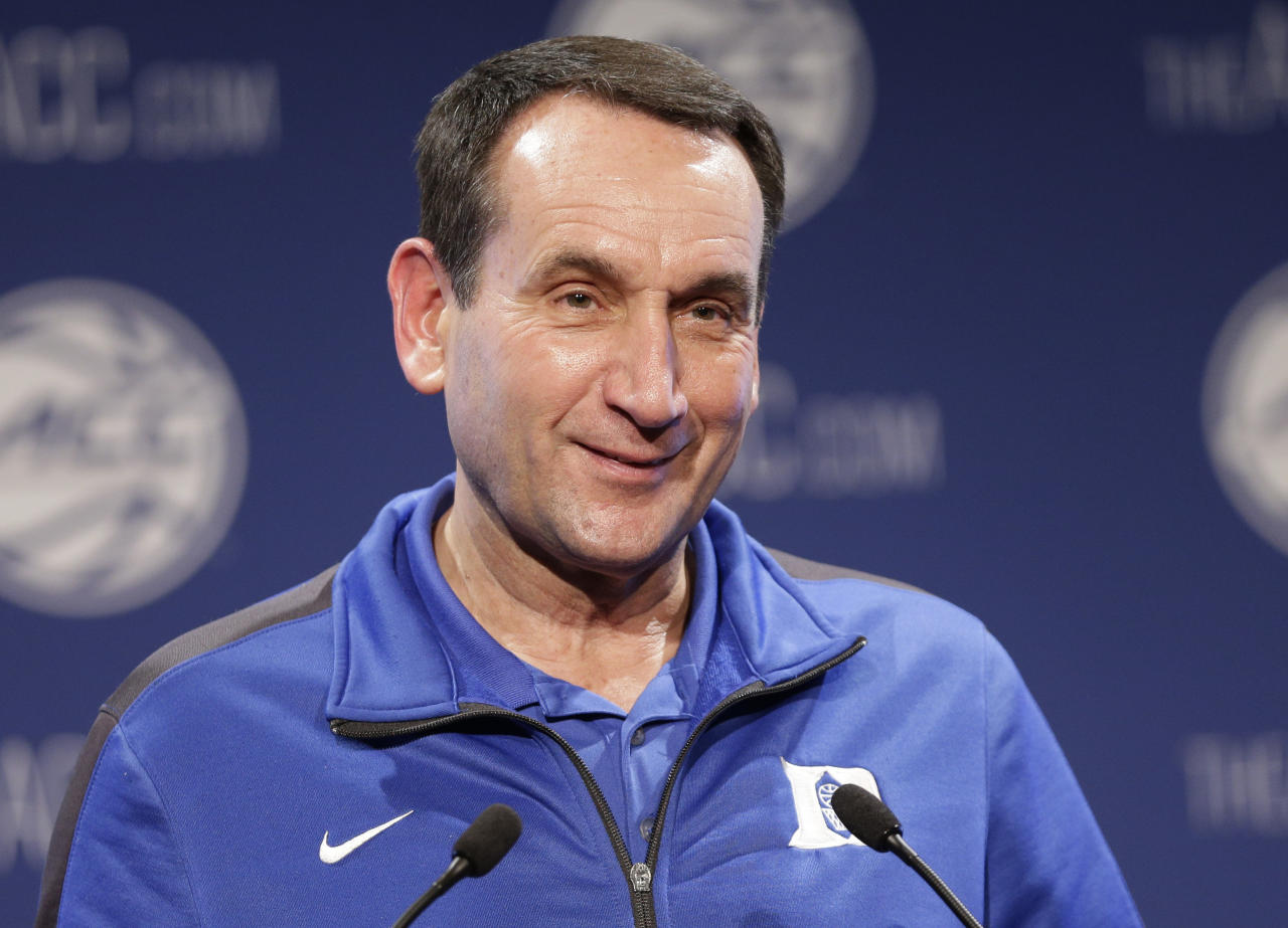 FILE - In this Oct. 28, 2015, file photo, Duke NCAA college basketball coach Mike Krzyzewski answers a question during the Atlantic Coast Conference men's media day in Charlotte, N.C. The words Mike Krzyzewski uses to build winning basketball teams can develop stronger business ones. That's the thought behind PowerForward, a digital, video-based program that uses the Duke and former U.S. Olympic coach's themes to create discussions that can teach leadership in the corporate world. (AP Photo/Chuck Burton, File)