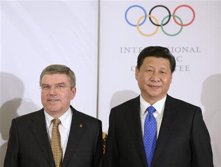 International Olympic Committee President Bach poses with Chinese President Xi before the IOC President's Gala Dinner in Sochi