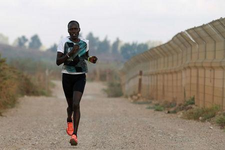 Lonah Chemtai, a Kenyan-born runner who will represent Israel in the women's marathon at the 2016 Rio Olympics, trains near their house in central Israel