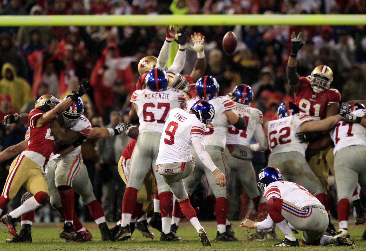 New York Giants kicker Lawrence Tynes (9) kicks the game winning field goal during overtime of the NFC Championship NFL football game Sunday, Jan. 22, 2012, in San Francisco. The Giants won 20-17 to advance to Super Bowl XLVI.(AP Photo/Marcio Jose Sanchez)