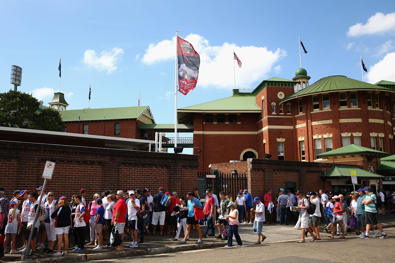 SYDNEY, AUSTRALIA - MARCH 23: Baseball fans arrive at the MLB match between the Los Angeles Dodgers and the Arizona Diamondbacks at Sydney Cricket Ground on March 23, 2014 in Sydney, Australia. (Photo by Cameron Spencer/Getty Images)