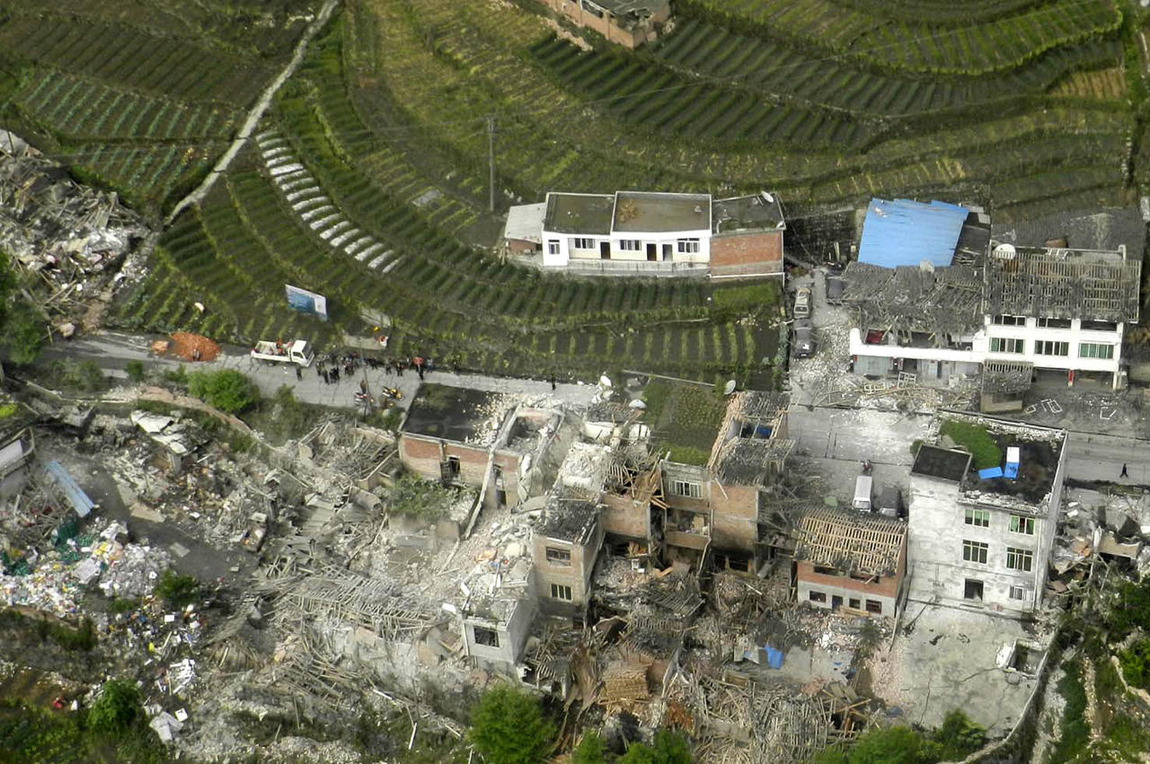 This aerial photo released by China's Xinhua news agency shows destroyed houses after a powerful earthquake hit Taiping town of Lushan County in Ya'an City, southwest China's Sichuan Province, Saturday, April 20, 2013. The powerful earthquake jolted Sichuan province Saturday near where a devastating quake struck five years ago. (AP Photo/Xinhua, Liu Yinghua) NO SALES
