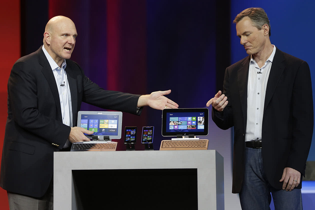 Microsoft CEO Steve Ballmer, left, and Qualcomm CEO Paul Jacobs talk about various Windows based products that utilize Qualcomm technology during Jacobs' keynote address at the Consumer Electronics Show.