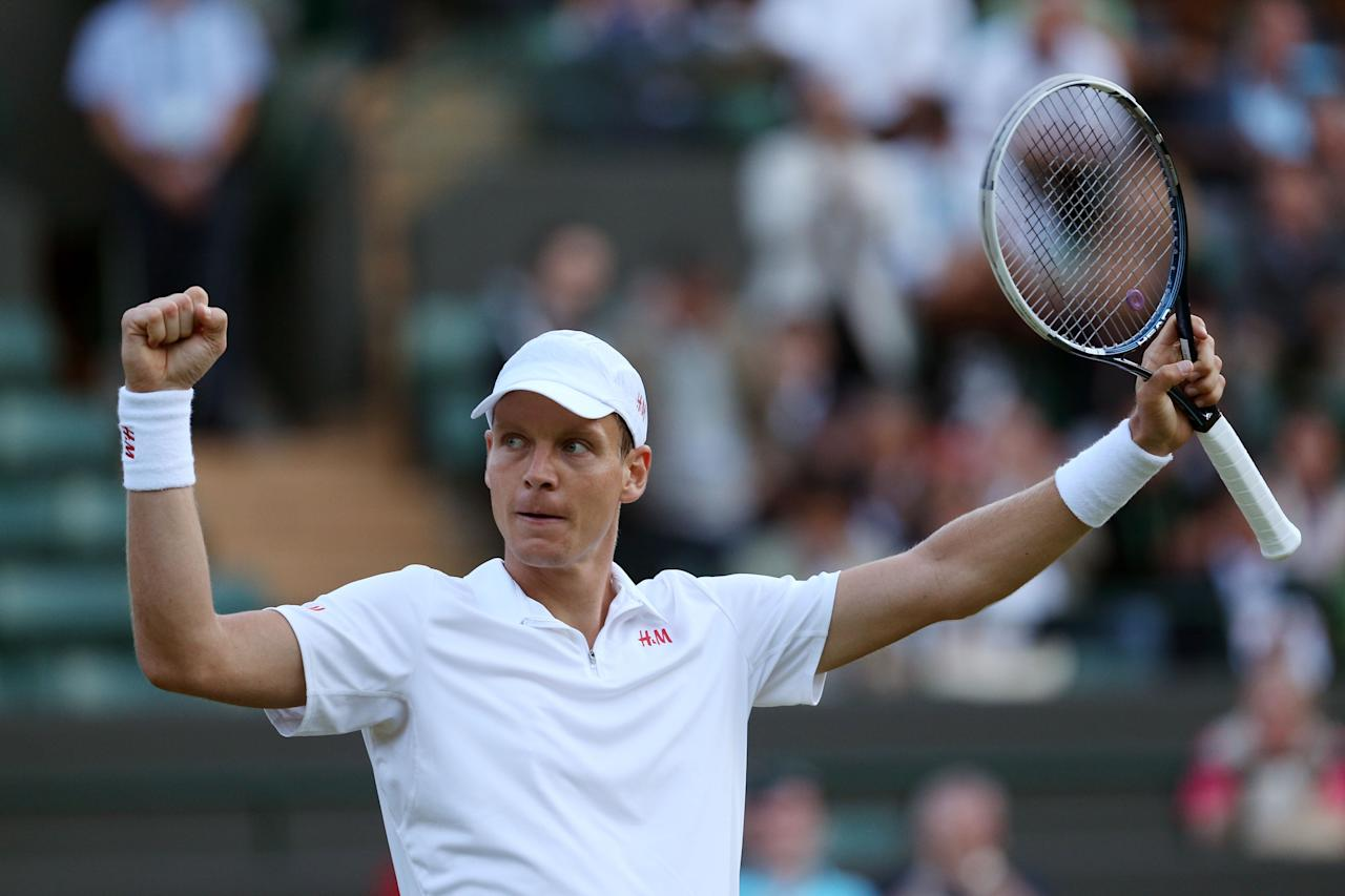 LONDON, ENGLAND - JULY 01: Tomas Berdych of Czech Republic celebrates match point during the Gentlemen's Singles fourth round match against Bernard Tomic of Australia on day seven of the Wimbledon Lawn Tennis Championships at the All England Lawn Tennis and Croquet Club on July 1, 2013 in London, England. (Photo by Clive Brunskill/Getty Images)