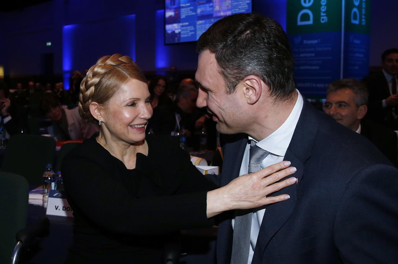 Ukrainian opposition politicians Yulia Tymoshenko and Vitaly Klitschko sit together at the European People's Party (EPP) Elections Congress in Dublin March 6, 2014. REUTERS/Suzanne Plunkett (IRELAND - Tags: POLITICS)
