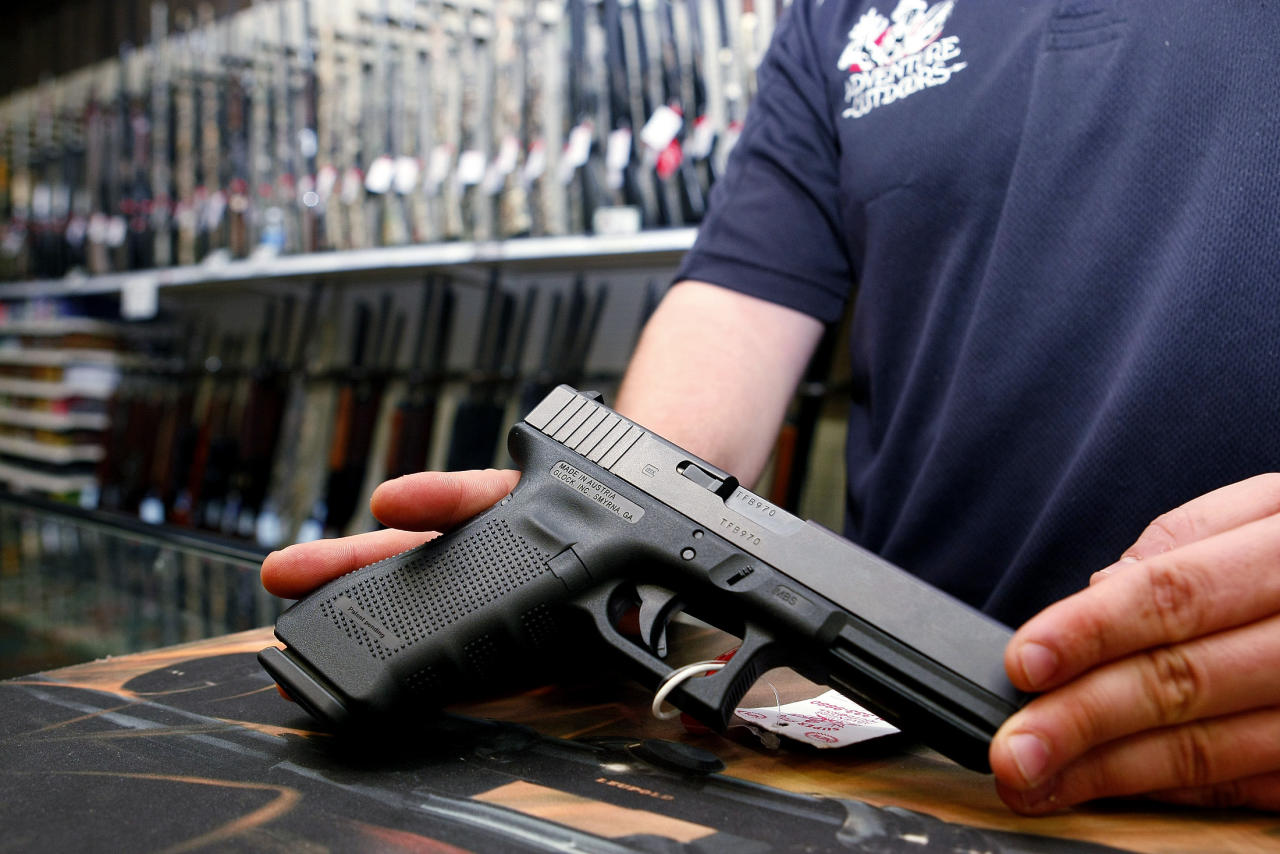 """A Glock handgun available in a raffle promotion is shown at Adventures Outdoors in Smyrna, Georgia, October 25, 2012. The store has promoted the raffle on billboards as a """"Vote. Win a rifle."""" but owner Jay Wallace has stated that all Georgia residents are eligible to enter.  REUTERS/Tami Chappell (UNITED STATES - Tags: POLITICS ELECTIONS SOCIETY)"""