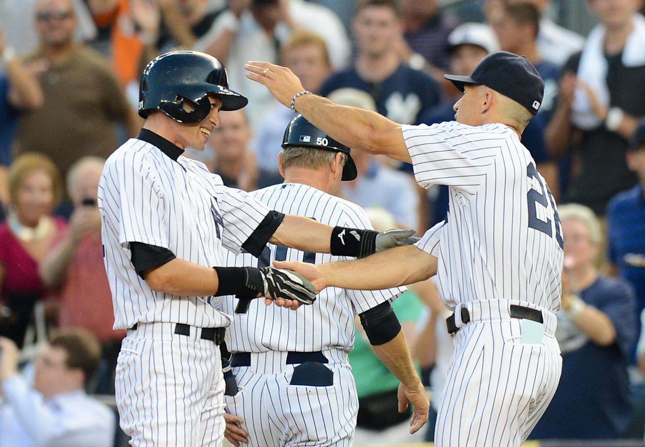 NEW YORK, NY - AUGUST 21: Ichiro Suzuki #31 of the New York Yankees is congratulated by manager Joe Girardiafter his 4,000th career hit on a single in the 1st inning of the New York Yankees game against the Toronto Blue Jays at Yankee Stadium on August 21, 2013 in the Bronx borough of New York City. (Photo by Ron Antonelli/Getty Images)