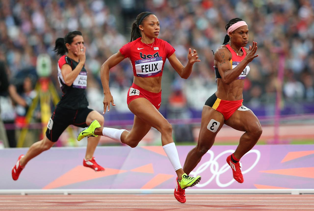 LONDON, ENGLAND - AUGUST 03:  (L-R) Allyson Felix of the United States and Toea Wisil of Papua New Guinea competes in the  Women's 100m Round 1 Heats on Day 7 of the London 2012 Olympic Games at Olympic Stadium on August 3, 2012 in London, England.  (Photo by Cameron Spencer/Getty Images)
