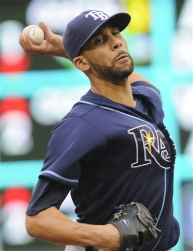 Tampa Bay Rays pitcher David Price throws against the Minnesota Twins in the first inning of a baseball game Saturday, Aug. 11, 2012 in Minneapolis. (AP Photo/Jim Mone)