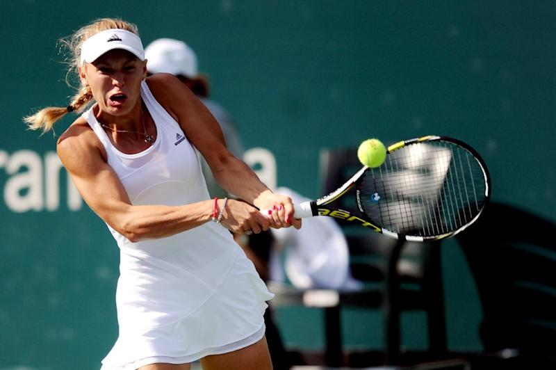 Caroline Wozniacki returns the ball to Italy's Roberta Vinci during the final of the Istanbul Cup on July 20, 2014 in Istanbul