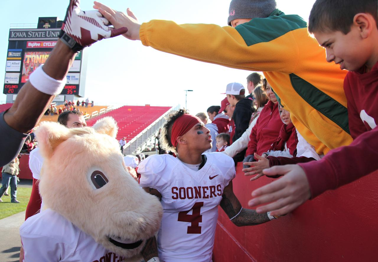 AMES, IA- NOVEMBER 3: Wide receiver Kenny Stills #4 of the Oklahoma Sooners celebrates with fans after the match-up against the Iowa State Cyclones on November 3, 2012 at Jack Trice Stadium in Ames, Iowa.  Oklahoma lead Iowa State 27-20 at the half.  (Photo by Matthew Holst/Getty Images)