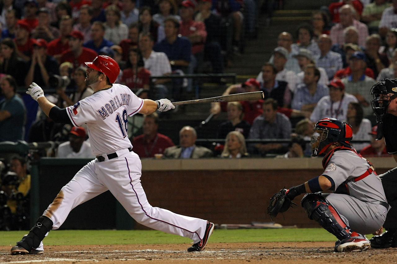 ARLINGTON, TX - OCTOBER 24: Mitch Moreland #18 of the Texas Rangers hits a solo home run in the third inning during Game Five of the MLB World Series against the St. Louis Cardinals at Rangers Ballpark in Arlington on October 24, 2011 in Arlington, Texas.  (Photo by Tom Pennington/Getty Images)