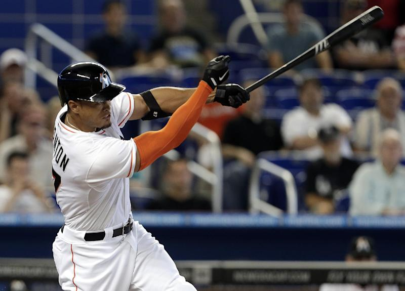Stanton rallies Marlins past Rockies 8-5