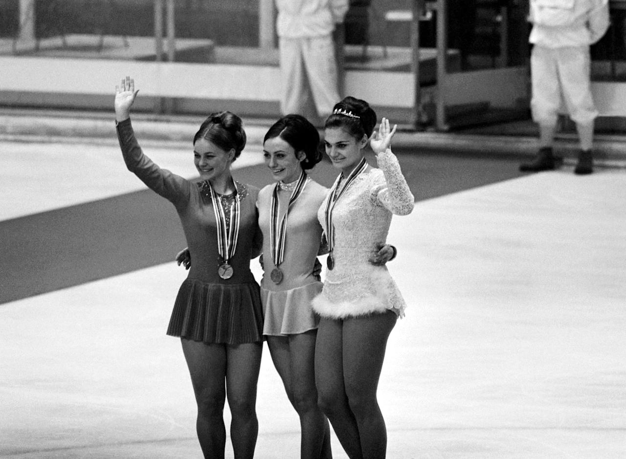 Women Olympic Skating Medalists on the podium at Grenoble, France, after receiving their medals on Feb. 10 1968. From left to right: Gabriele Seyfert of France, who won the silver medal, Peggy Fleming of the U.S.A. who won the gold medal and Hana Maskova of Czechoslovakia who won the bronze medal. (AP Photo)
