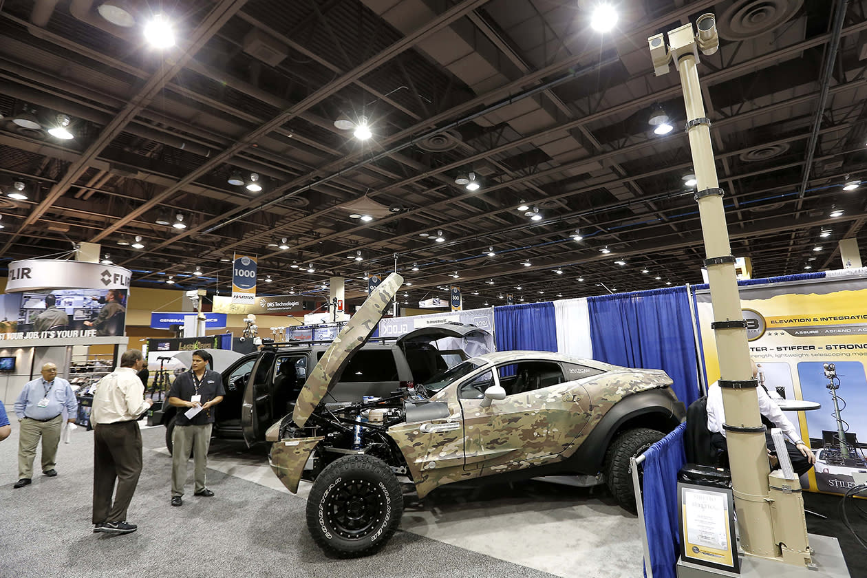 An armored vehicle vendor showcases their off road vehicles at the Border Security Expo in Phoenix.