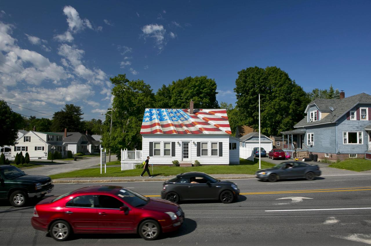 The roof of an insurance company proudly shows off the Stars and Stripes on Flag Day, Friday, June 14, 2013, in Lewiston, Maine. Tolman Associates hired an artist to paint the roof in response to the 9/11 terrorist attacks. President Woodrow Wilson established June 14 as Flag Day in 1916. (AP Photo/Robert F. Bukaty)
