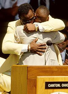 Jared Payton hugs his father Walter Payton at the 1993 Hall of Fame induction ceremony at the Pro Football Hall of Fame