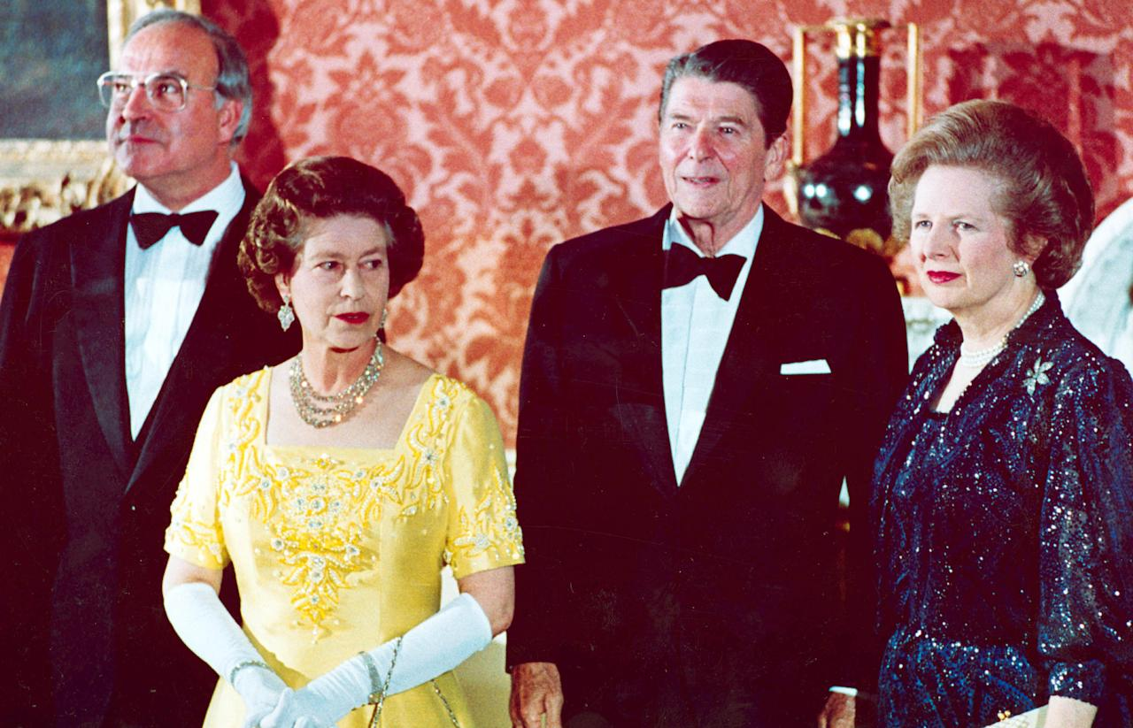 FILE - In a June 10, 1984 file photo, Britain's Queen Elizabeth II, second left, stands with, West German Chancellor Helmut Kohl, left, U.S. President Ronald Reagan, second right, and Britain's Prime Minister Margaret Thatcher at London's Buckingham Palace, prior to a dinner for summit leaders. Thatchers former spokesman, Tim Bell, said that the former British Prime Minister Margaret Thatcher died Monday morning, April 8, 2013, of a stroke. She was 87. (AP Photo, File)