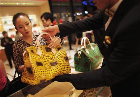 File photo of a woman shopping in a Louis Vuitton store in downtown Shanghai