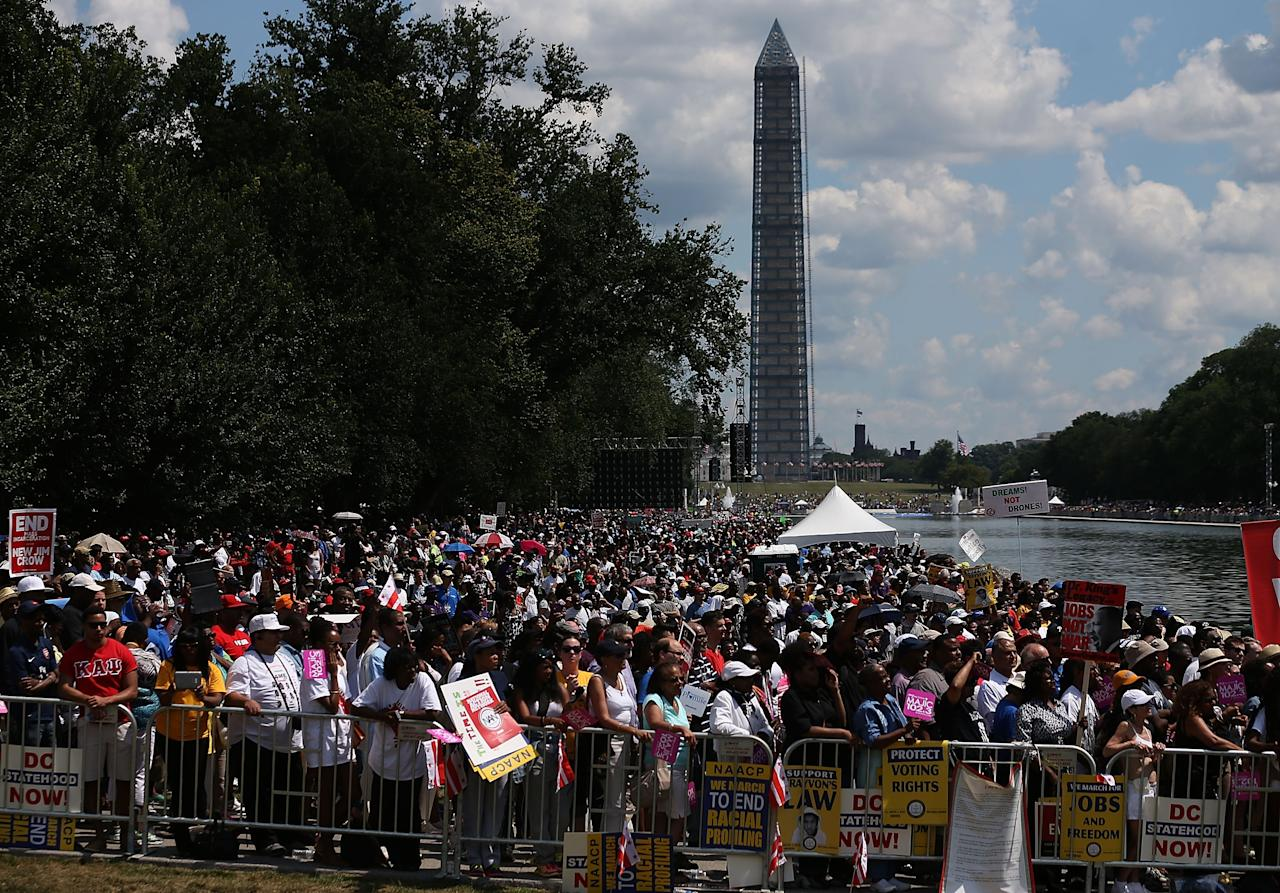 WASHINGTON, DC - AUGUST 24: People gather at the Reflecting Pool to listen to speakers during the 50th anniversary of the March on Washington and Dr. Martin Luther King, Jr.'s 'I have a Dream' speech at the Lincol Memorial on August 24, 2013 in Washington, DC. The event included a commemorative march and rally along the historic route followed on August 28, 1963 and is being led by civil rights leader Al Sharpton and Martin Luther King III, King's oldest son.Ê (Photo by Mark Wilson/Getty Images)