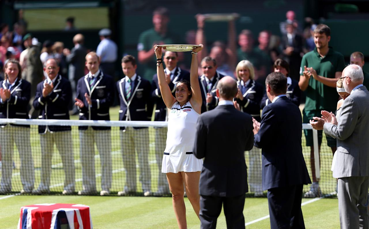 France's Marion Bartoli lifts the trophy after beating Germany's Sabine Lisicki during day twelve of the Wimbledon Championships at The All England Lawn Tennis and Croquet Club, Wimbledon.