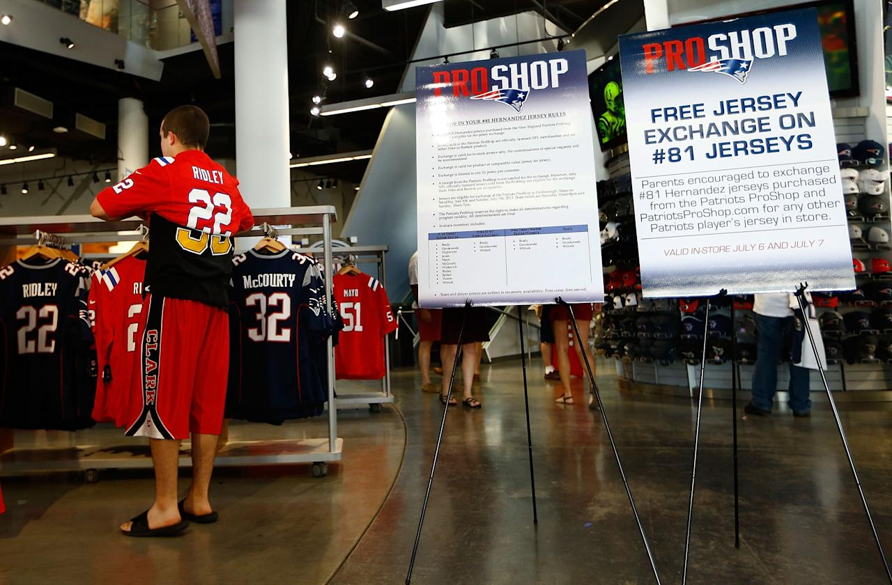 FOXBORO, MA - JULY 7: New England Patriots fans try on other jersey's after trading in their Aaron Hernandez jerseys during a free exchange at the pro shop at Gillette Stadium on July 7, 2013 in Foxboro, Massachusetts. (Photo by Jared Wickerham/Getty Images)