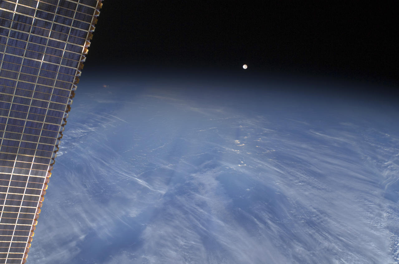A full moon is visible with part of the International Space Station's solar array wing in this view above Earth's horizon, photographed by a crew member from the International Space Station while Space Shuttle Discovery (STS-128) remains docked with the station in this NASA handout photo taken September 3, 2009.      REUTERS/NASA/Handout   (UNITED STATES SCI TECH IMAGES OF THE DAY) FOR EDITORIAL USE ONLY. NOT FOR SALE FOR MARKETING OR ADVERTISING CAMPAIGNS