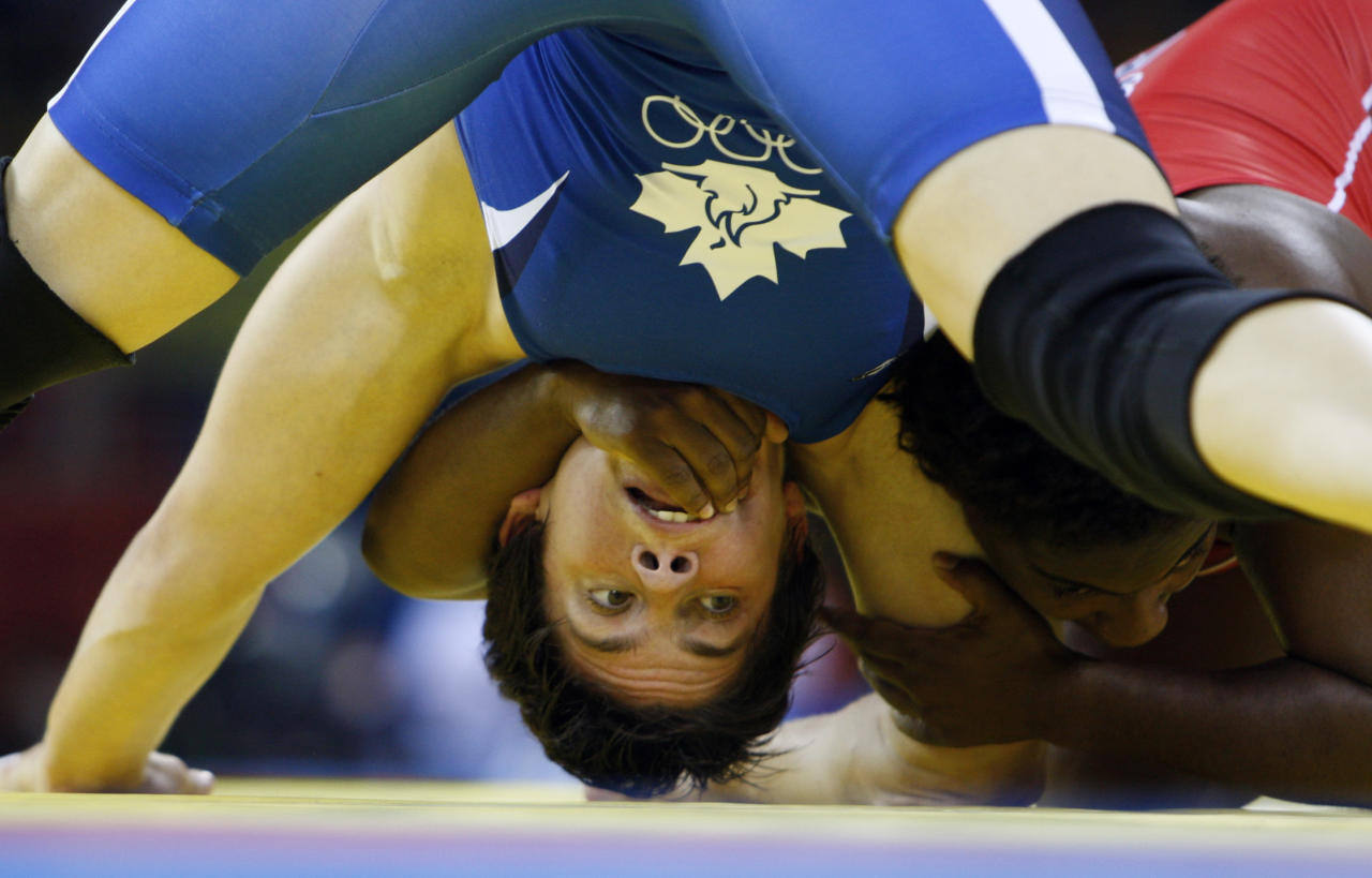 Randi Miller of U.S, in red, wrestles against Martine Dugernier of Canada for bronze of 63kg women's freestyle wrestling competition of the Beijing 2008 Olympics in Beijing, Sunday, Aug. 17, 2008. Miller won bronze. (AP Photo/Saurabh Das )