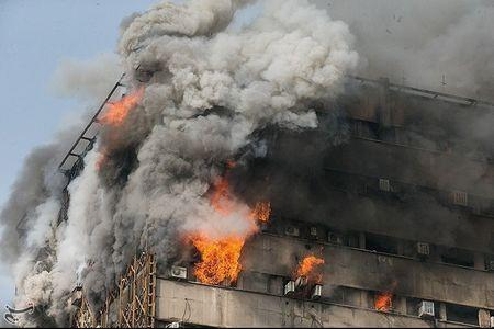 Troops, rescuers search for trapped firefighters after Iran building collapse