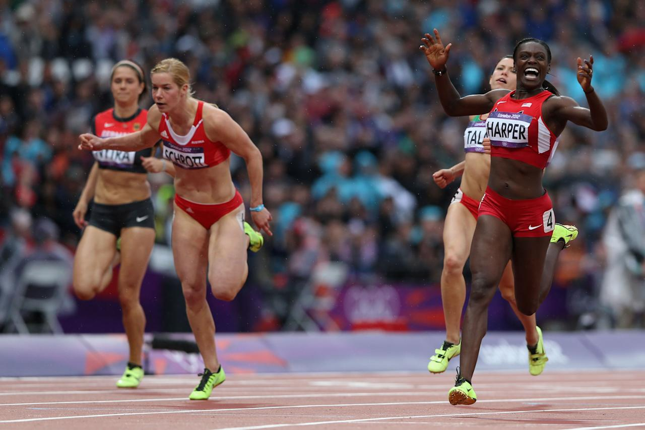 LONDON, ENGLAND - AUGUST 07:  Dawn Harper of the United States leads the pack in the Women's 100m Hurdles Semifinals on Day 11 of the London 2012 Olympic Games at Olympic Stadium on August 7, 2012 in London, England.  (Photo by Streeter Lecka/Getty Images)