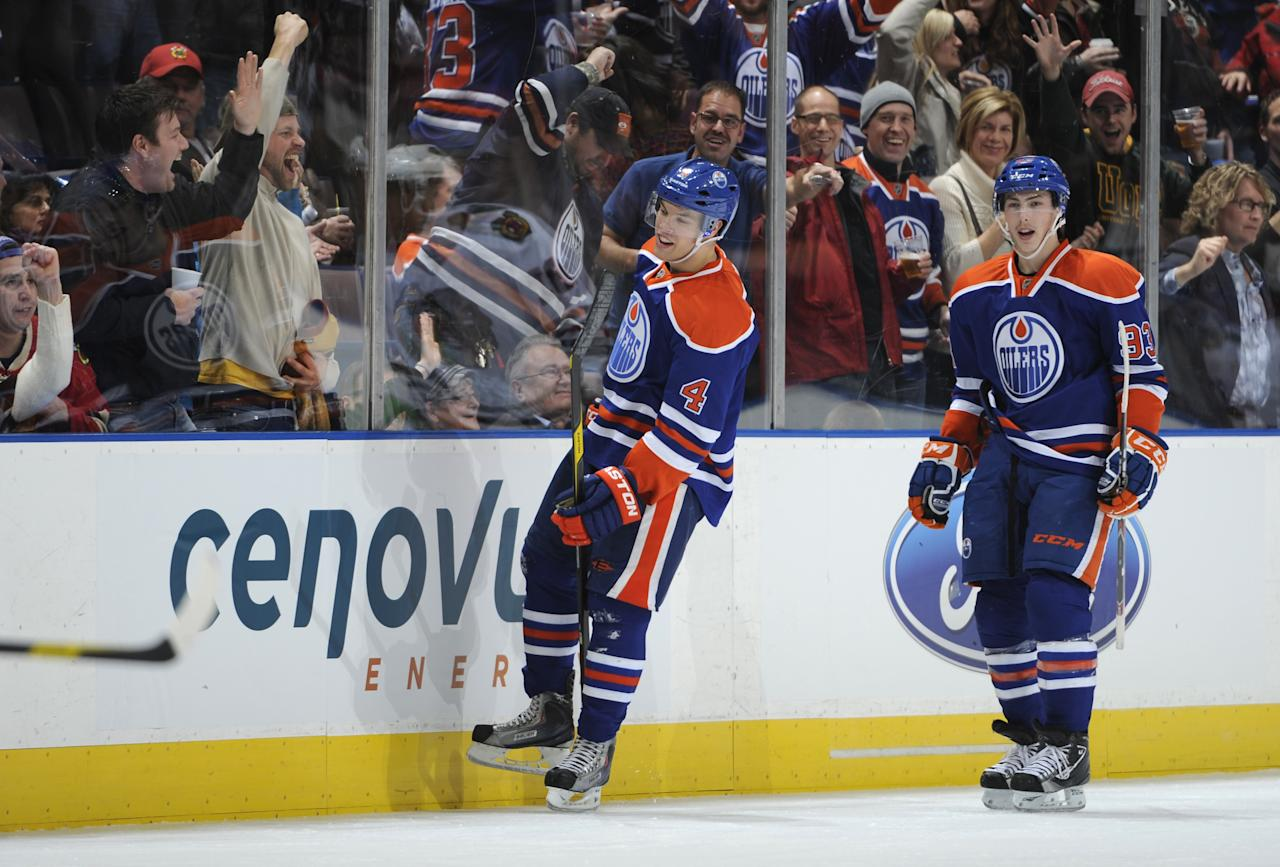 EDMONTON, CANADA - NOVEMBER 19: Taylor Hall #4 and Ryan Nugent-Hopkins #93 of the Edmonton Oilers celebrate Taylor's hat trick goal against the Chicago Blackhawks on November 19, 2011 at Rexall Place in Edmonton, Alberta, Canada. (Photo by Dale MacMillan/Getty Images)