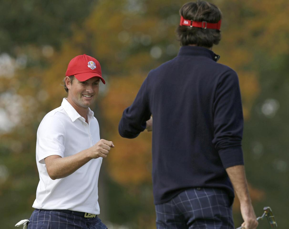 USA's Webb Simpson, left, is congratulated by Bubba Watson after Simpson made a putt to win the first hole during a four-ball match at the Ryder Cup PGA golf tournament Friday, Sept. 28, 2012, at the Medinah Country Club in Medinah, Ill. (AP Photo/David J. Phillip)