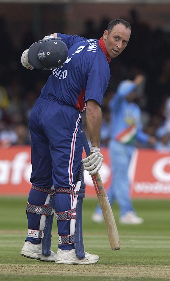 LONDON, ENGLAND - JULY 13:  Nasser Hussain of England points to the three on his back after his century during the match between England and India in the NatWest One Day Series Final at Lord's in London, England on July 13, 2002. (Photo by Tom Shaw/Getty Images)