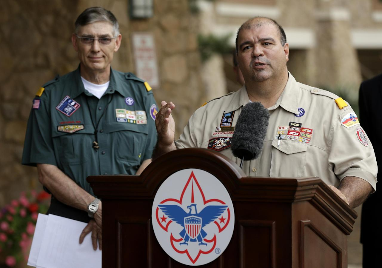 Boy Scouts of America National Commissioner Tico Perez, front, addresses reporters questions as BSA National President Wayne Perry, left, rear, watches Thursday, May 23, 2013, in Grapevine, Texas. Local leaders of the Boy Scouts of America voted Thursday to ease a divisive ban and allow openly gay boys to be accepted into the nation's leading youth organization — one of the most dramatic moves the organization has made in a century. (AP Photo/Tony Gutierrez)