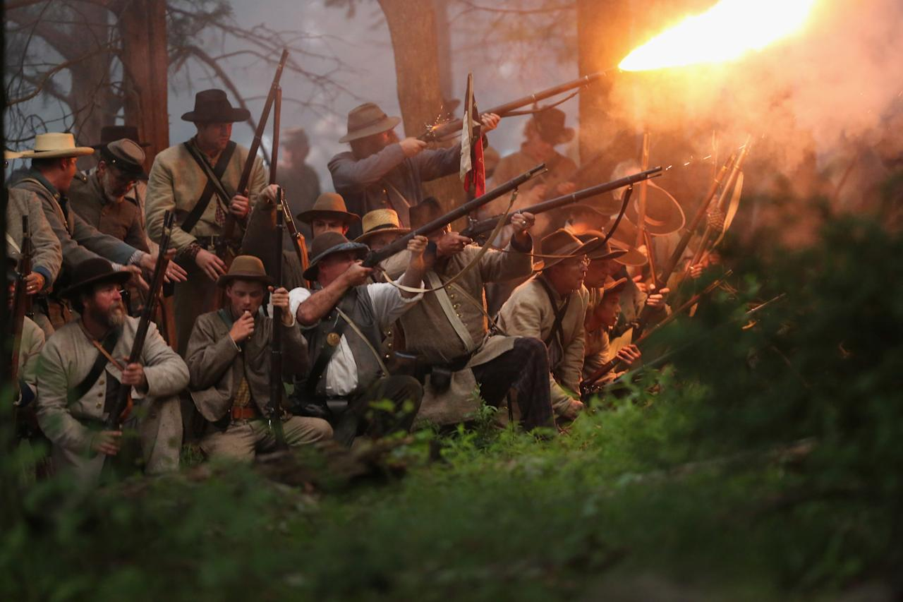GETTYSBURG, PA - JUNE 29: Confederate Civil War re-enactors launch an evening attack during a three-day Battle of Gettysburg re-enactment on June 29, 2013 in Gettysburg, Pennsylvania. Some 8,000 re-enactors from the Blue Gray Alliance are participating in events marking the 150th anniversary of the July 1-3, 1863 Battle of Gettysburg. General Robert E. Lee's Army of Northern Virginia was defeated on the third day of the battle, considered the turning point in the American Civil War and a watershed moment in the nation's history. Union and Confederate armies suffered a combined total of some 46,000-51,000 casualties over three days, the highest of any battle the four-year war. (Photo by John Moore/Getty Images)