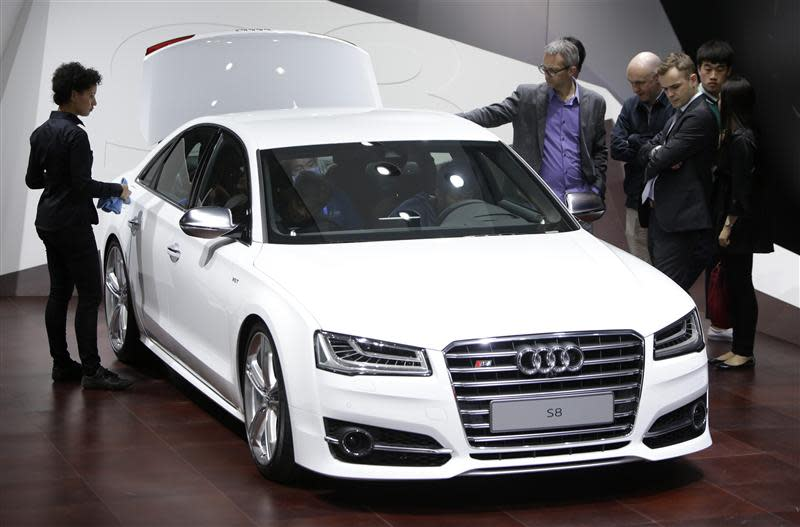 Visitors look at an Audi S8 car at Auto China 2014 in Beijing