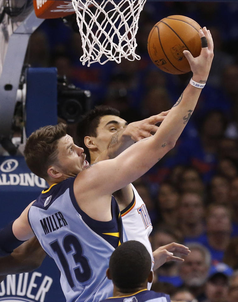 Memphis Grizzlies forward Mike Miller (13) grabs a rebound in front of Oklahoma City Thunder center Steven Adams (12) in the first quarter of Game 7 of an opening-round NBA basketball playoff series in Oklahoma City, Saturday, May 3, 2014. (AP Photo/Sue Ogrocki)
